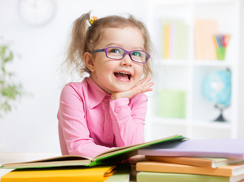 young pediatric girl with purple glasses